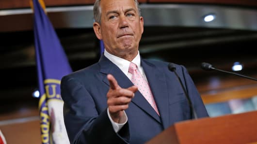 House Speaker John Boehner, R-Ohio, answers questions during a press conference on Capitol Hill, July 24, 2014, in Washington.