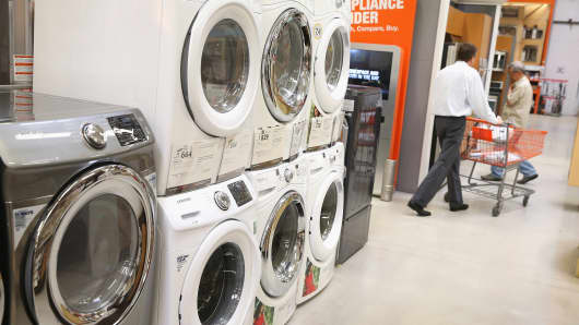 Household appliances are offered for sale at a Home Depot store.