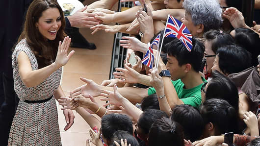 Catherine, Duchess of Cambridge greets members of the public in Singapore as part of the Diamond Jubilee tour in 2012.