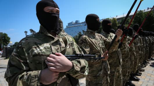 Soldiers in Kiev take an oath of allegiance to the people of Ukraine on July 16, 2014.