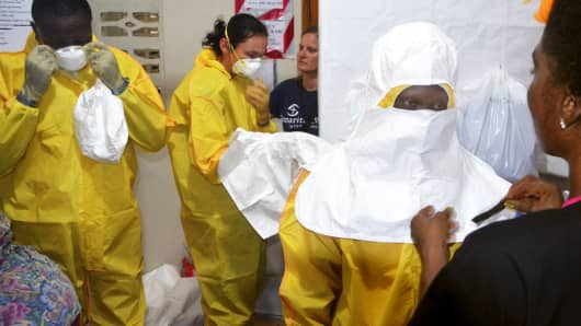 Staff of the Christian charity Samaritan's Purse putting on protective gear in the ELWA hospital in the Liberian capital Monrovia, July 24, 2014.