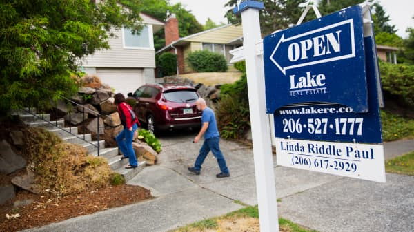 Potential home buyers arrive at an open house in Seattle.