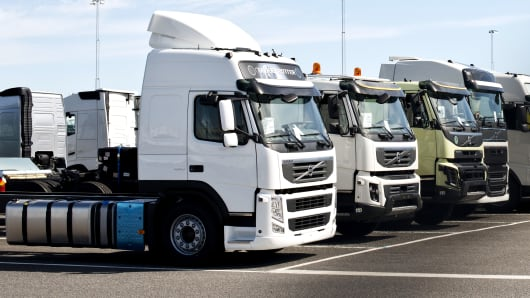 A row of new Volvo truck units.