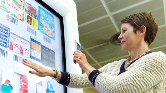 Tesco's virtual grocery store in the Gatwick Airport is an example of how the physical and digital worlds are expected to be fused together in 25 years.