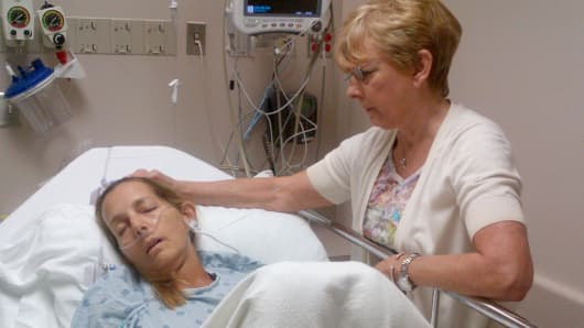 Andrea Sloan, an ovarian cancer patient, in the hospital with her mother.