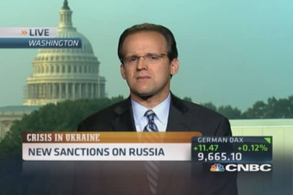 EU, US slap new sanctions on Russia