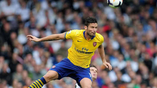 Olivier Giroud of Arsenal jumps to head the ball during the Barclays Premier League match between Fulham and Arsenal at Craven Cottage on August 24, 2013 in London.