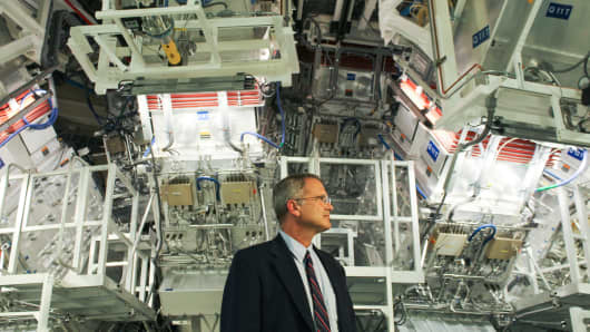Jeff Wisoff in front of the world's largest laser at the Lawrence Livermore National Laboratory.