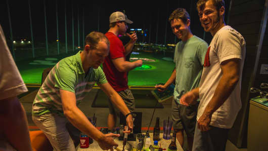Customers play at the opening of TopGolf's Scottsdale, Arizona location.