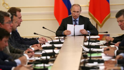 Russian President Vladimir Putin speaks during a government meeting on the Russian economy on July 30, 2014 in Moscow, Russia.