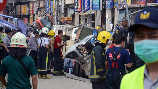 Rescue workers search through the explosion site in southern Kaohsiung city on August 1, 2014. A series of powerful gas blasts killed at least 22 people and injured up to 270 in the southern Taiwanese city of Kaohsiung,