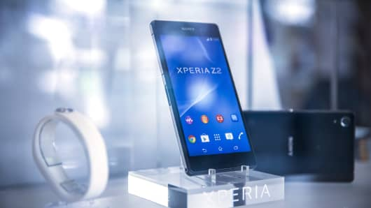 A Sony Xperia Z2 smartphone and compatible devices, manufactured by Sony Corp, are displayed for sale inside a Bouygues Telecom store, operated by Bouygues SA in Paris, France, on Thursday, July 3, 2014.