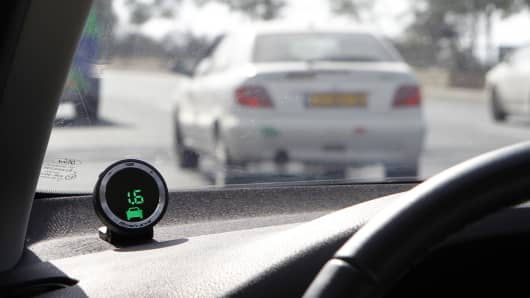 Part of the Mobileye driving assist system is seen on the dashboard of a vehicle during a demonstration for the media in Jerusalem.