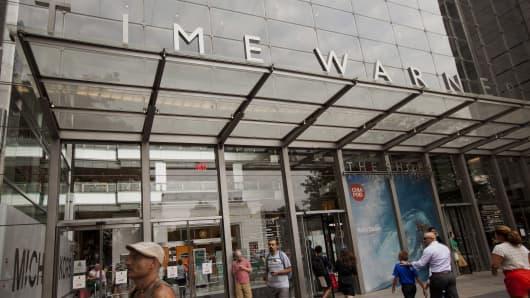 Pedestrians walk past the Time Warner Center in New York.