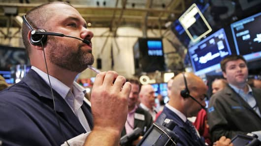 Traders work on the floor of the New York Stock Exchange, August 1, 2014, in New York.