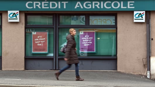 A pedestrian passes a Credit Agricole SA bank branch in Rodez, France.