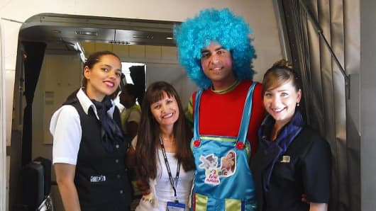 A clown is part of the cabin crew on select El Al flights from Tel Aviv to New York and other cities this summer.