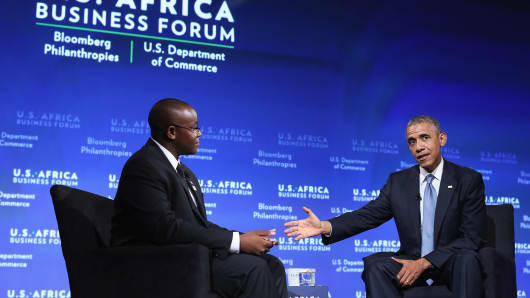 U.S. President Barack Obama engages in a question-and-answer session with Takunda Ralph Michael Chingonzo of Zimbabwe (L) during the U.S.-Africa Business Forum in Washington, DC.