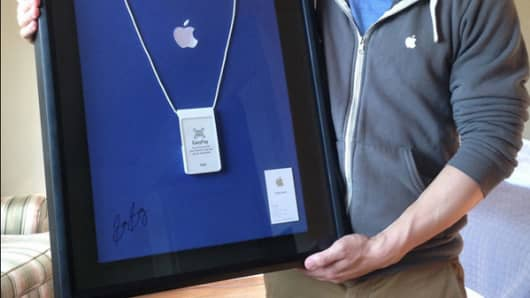 Apple Inc. employee Sam Sung auctions off his business card on eBay.