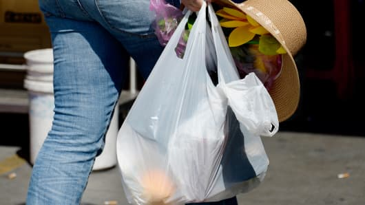 A pedestrian carries a single-use plastic bag while shopping in the Chinatown section of Los Angeles, June 24, 2014.