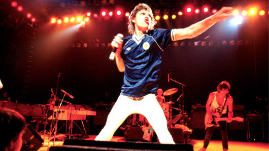 Singer Mick Jagger of the Rolling Stones, wearing a Scotland football shirt, performing on stage in May 1982.