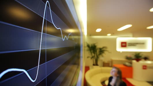 An electronic board displays a rising stock index curve at the Micex-RTS Moscow Exchange, Russia's benchmark stock index, in Moscow.