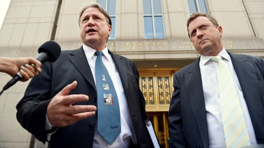 Lawyers Jerome H. Mooney, left, and Vincent S. Verdiramo speak outside Federal Court after their client, Indonesian-born wine dealer Rudy Kurniawan, was sentenced to 10 years in prison, August 7, 2014, in New York.