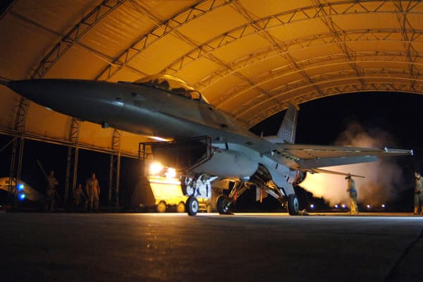Air Force airmen conduct an operational check on a F-16 Fighting Falcon at Balad Air Base, Iraq, in this March 22, 2007 file photo.