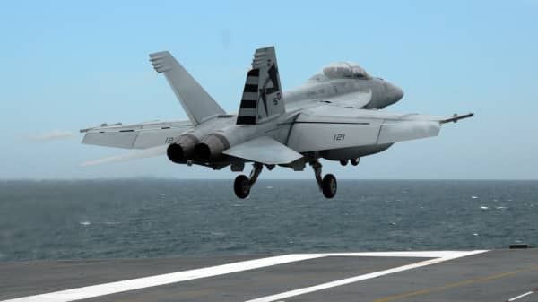 File photo of an F/A-18C Hornet taking off from the USS George H.W. Bush aircraft carrier.
