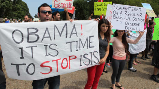Yezidis living in Washington stage a protest outside the White House in Washington, United States, August 7, 2014, against the ISIS attacks on Yezidis in Iraq.