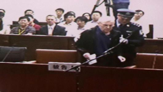 An internal court video shows British investigator Peter Humphrey arriving at a courtroom after a lunch break, during his trial at Shanghai No.1 Intermediate People's Court August 8, 2014.