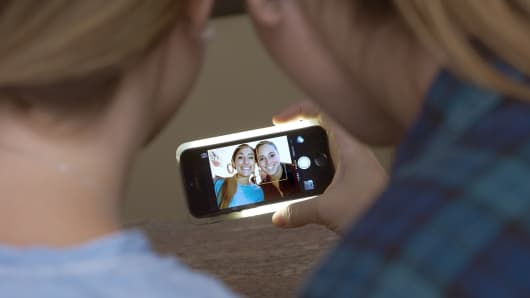 The LuMee case allows users to adjust the brightness of the light for the perfect selfie.