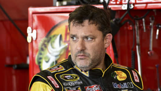 Tony Stewart stands in the garage area after a practice session for Sunday's NASCAR Sprint Cup Series auto race at Watkins Glen International, in Watkins Glen N.Y.