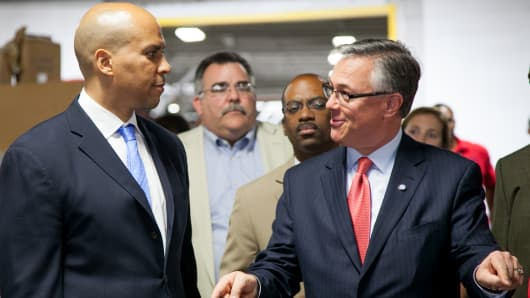 New Jersey Senator Cory Booker and Joseph Szabo, the administrator of the U.S. Federal Railroad Administration, tour the warehouse for the New Jersey High Speed Rail Improvement Project.