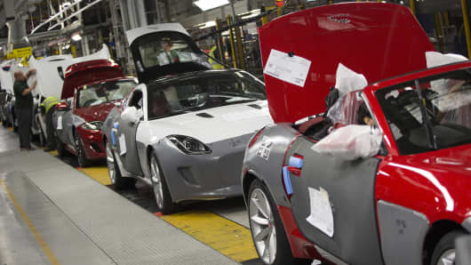 Luxury Jaguar XK and F-type automobiles, produced by Jaguar Land Rover Plc, a unit of Tata Motors Ltd., travel along the production line at the company's assembly plant in Castle Bromwich, U.K.
