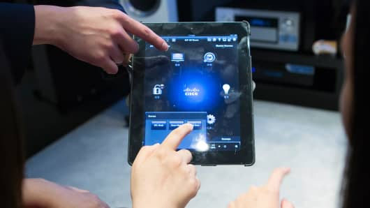 Cisco Systems' Smart and Connected Residence application is demonstrated on a tablet device at a store in Hong Kong.