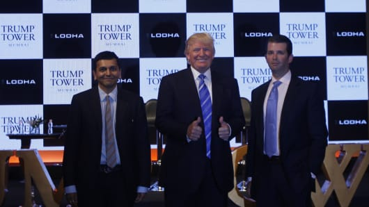 Donald J Trump, Chairman and President of The Trump with Donald J Trump Jr, Executive Vice President and Abhishek Lodha, MD of Lodha Group at the launch of Trump Tower on August 12, 2014 in Mumbai, India.