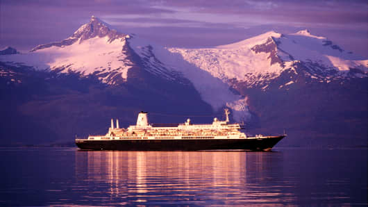 A cruise ship in the  Stephens Passage, Alaska at sunset.