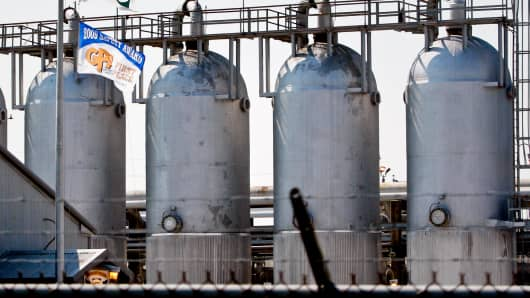 Natural gas sits in storage tanks in Erath, Louisiana.