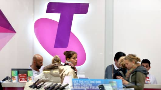 Shoppers in a Telstra retail store in Sydney's CBD browse products in Sydney, Australia.