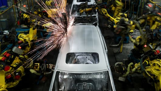 Robots weld the frames of Honda Odyssey minivans at the Honda Manufacturing of Alabama facility in Lincoln, Alabama.