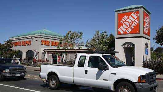 Pickup trucks leave a Home Depot store in El Cerrito, Calif.