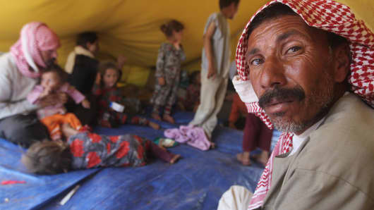 Iraqi Yazidi refugees rest inside a tent at the Newroz camp in Hasaka province, northeastern Syria.