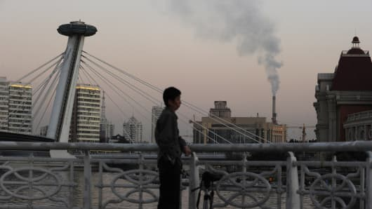 Smoke is seen rising from a chimmny in the northern port city of Tianjin, China.