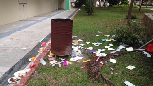 Offerings left at a public housing estate in Singapore