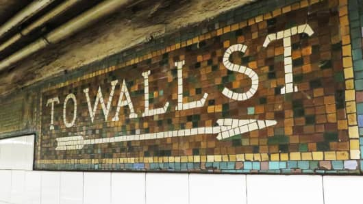 Wall Street sign in subway station, New York City.