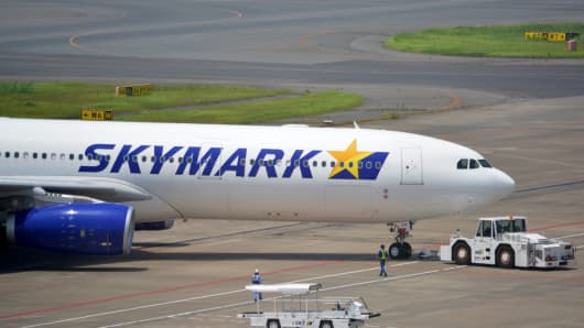 Skymark Airlines' Airbus A330-300 plane taxis to take off from Tokyo's Haneda airport.