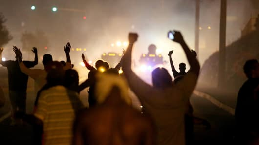 Demonstrators and police in Ferguson, Missouri, August 17, 2014.