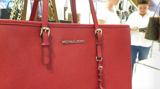 Michael Kors, retail sales shopping shoppers Macy's consumers consumer confidence