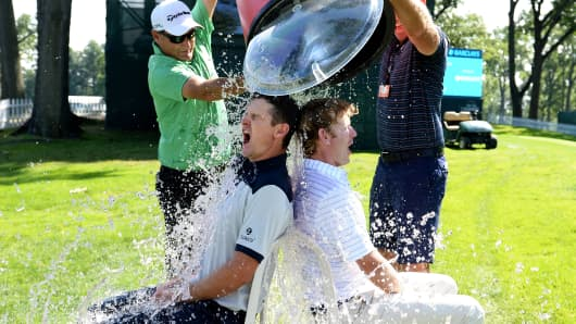 Golfers Justin Rose and Brandt Snedeker  take the 'Ice Bucket Challenge'  after a practice round prior to The Barclays at The Ridgewood Country Club on Aug. 19, 2014 in Paramus, N.J.